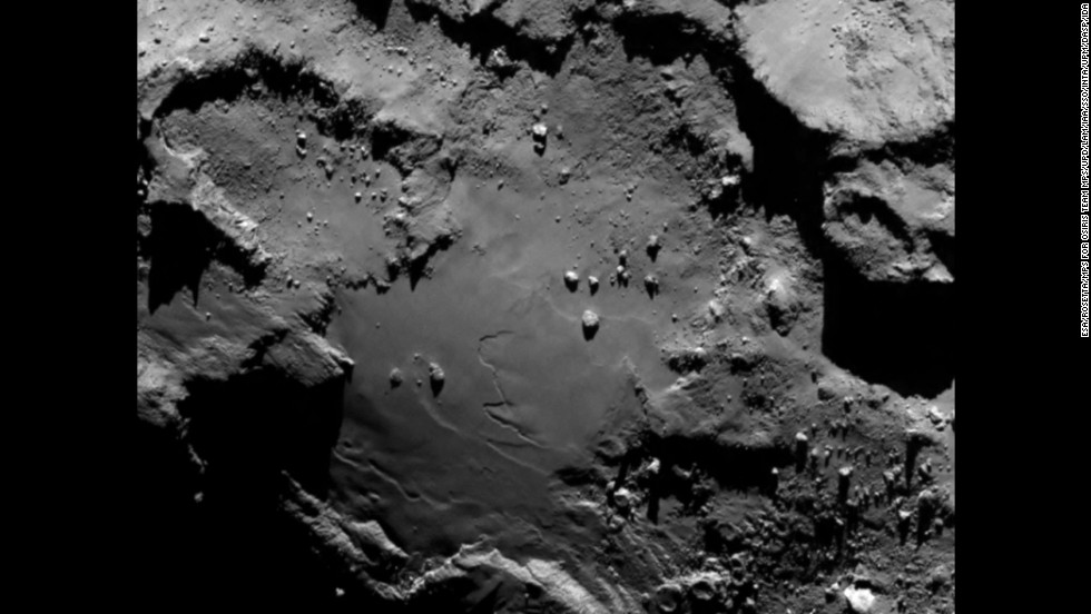 "The spacecraft sent this image as it approached the comet on August 6, 2014. From a distance of nearly 81 miles (130 kilometers), it reveals detail of the smooth region on the comet's ""body"" section."