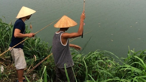 """The Perfume River in Hue, Vietnam, is special to CNN's Dan Tham because his mother and grandparents were born there. He visited Vietnam in June and was """"naturally drawn to the river, its beauty and colors,"""" he said. """"I would watch the boats drift down the river that Huetians seem to treat with great reverence."""""""
