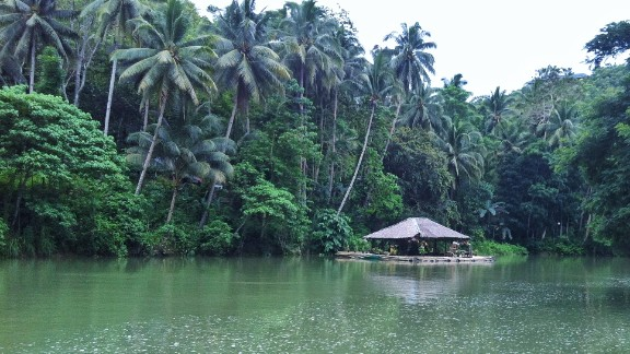 """Cruising along the Loboc River on Bohol Island in the Philippines, Sylvie Nguyen said she loved the local charm, like this """"floating stage of dancing and singing ladies."""""""