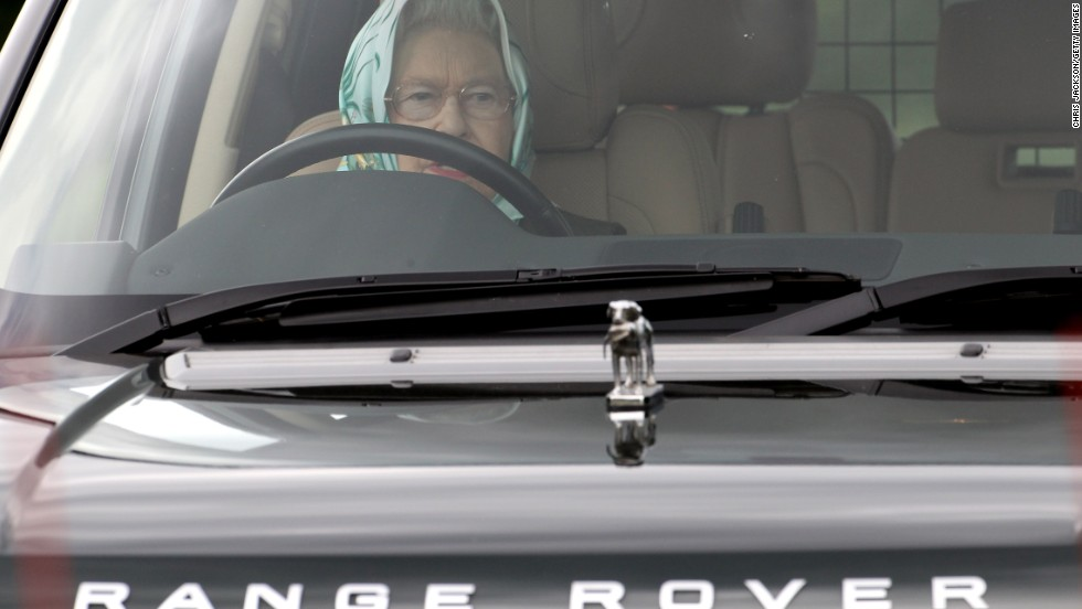 Queen Elizabeth II drives her Range Rover as she attends the Windsor Horse Show in May 2011.
