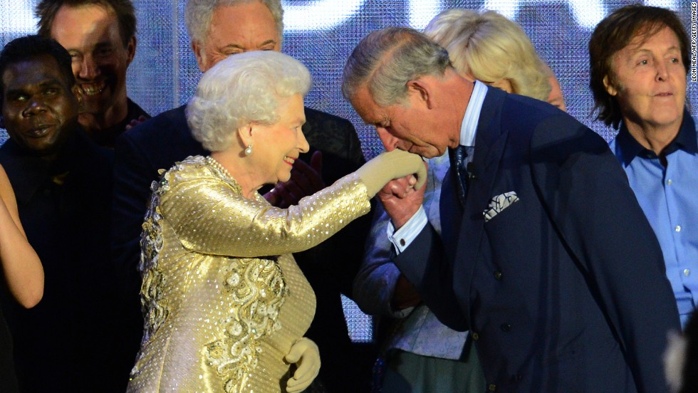 Prince Charles kisses his mother's hand on stage as singer Paul McCartney, far right, looks on at the Diamond Jubilee concert held June 4, 2012, at Buckingham Palace. The Diamond Jubilee celebrations marked Elizabeth's 60th anniversary as Queen.