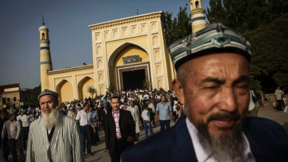 Uyghur men leave the Id Kah Mosque after Eid prayers in July 2014 in old Kashgar, Xinjiang province, China.