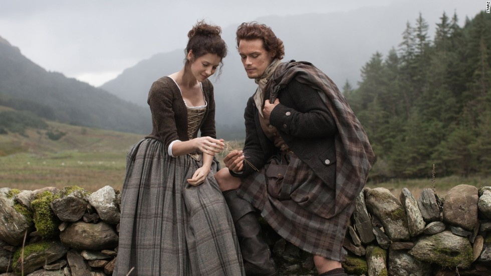 "Claire Randall (Caitriona Balfe) and Jamie Fraser (Sam Heughan), on Starz show ""Outlander"". A British-American TV drama series based on Diana Gabaldon's ""Outlander"" novel series, the story follows WWII combat nurse Claire Randall who travels back in time to 1743 where she encounters Scottish warrior Jamie Fraser."