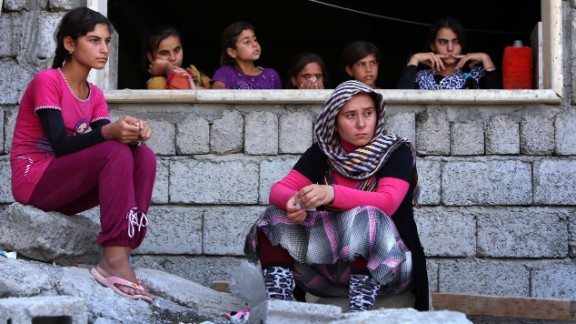 Iraqi Yazidi women, who fled the violence in Sinjar, Iraq, take shelter at a school in Dohuk, Iraq, on August 5.