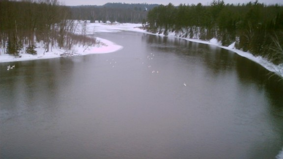 On a cold day in March 2006, Stephen Messenger photographed the Au Sable River from a highway bridge in Oscoda, Michigan. The river runs 138 miles and empties out into Lake Huron. You can see this sprawling river from the many lookout platforms built by the U.S. Forest Service throughout Michigan.   Desktop viewers: Click the double arrow to see more photos.
