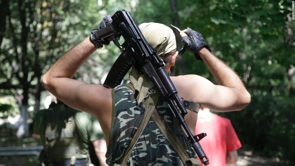 A pro-Russian rebel adjusts his weapon in Donetsk on August 6.
