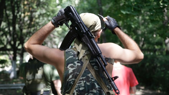 A pro-Russia rebel adjusts his weapon in Donetsk on August 6.
