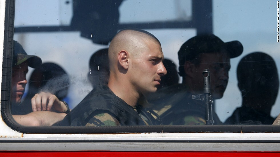 Ukrainian servicemen sit on a bus near Slovyansk, Ukraine, on Tuesday, August 5.