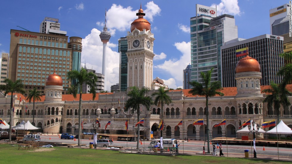 <strong>Sultan Abdul Samad Building's Clock Tower, Kuala Lumpur, Malaysia</strong><br /><strong>Completed: </strong>1897<br /><strong>Height: </strong>40 meters (131 feet)<br /><strong>Architect: </strong>A.C. Norman<br /><strong>Special feature</strong><br />Topped with a golden dome, the building is a blend of Moorish and British design.<br /><em>More on the next slide.</em>