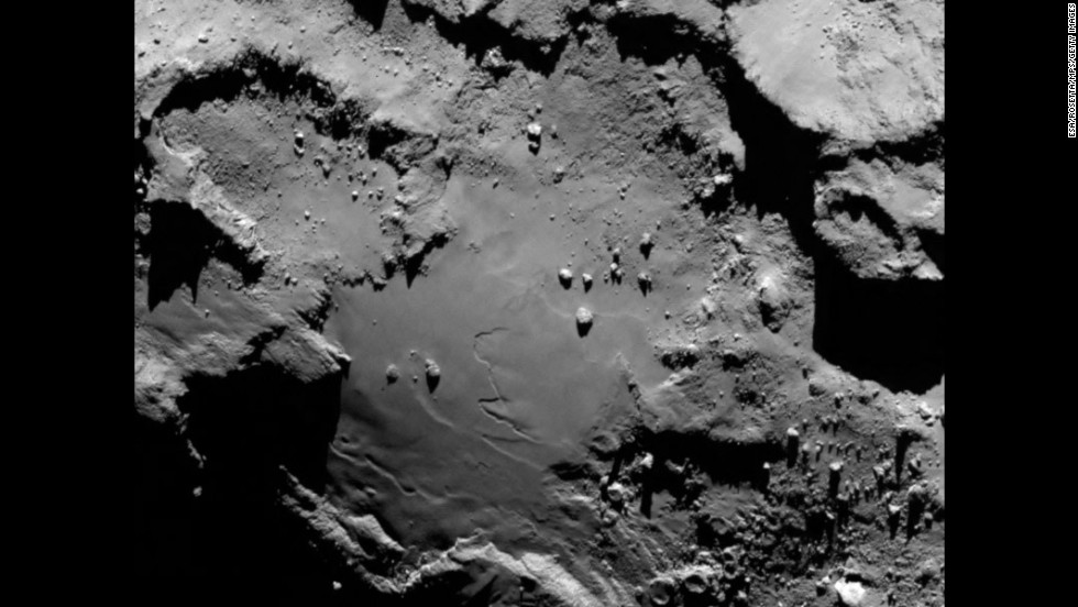 "The European Space Agency's Rosetta spacecraft has become <a href=""http://www.cnn.com/2014/01/17/tech/gallery/rosetta-the-comet-chaser/index.html"">the first probe to orbit a comet</a> after arriving at its destination Wednesday, August 6. The spacecraft sent this image during its approach to comet 67P/Churyumov-Gerasimenko. From a distance of 130 kilometers (nearly 81 miles), it reveals detail of the smooth region on the comet's ""body"" section."