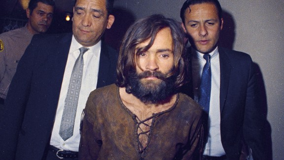 Manson is escorted to his arraignment on conspiracy-murder charges.