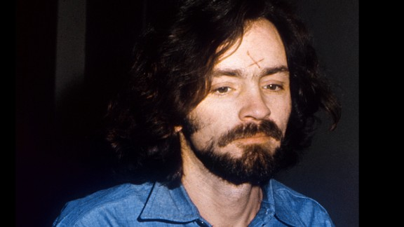 "Manson appears with an ""X"" cut into his forehead as the trial starts on June 16, 1970. It was said to symbolize being crossed out of society. He later altered the scar to become a swastika."