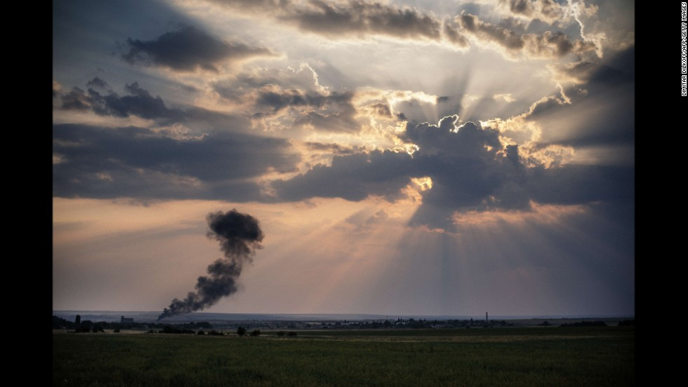 Smoke billows from a Ukrainian fighter jet crash near the village of Zhdanivka, Ukraine, on August 7.
