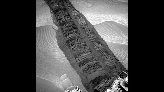 "Wheel tracks from Curiosity are seen on the sandy floor of a lowland area dubbed ""Hidden Valley"" in this image."