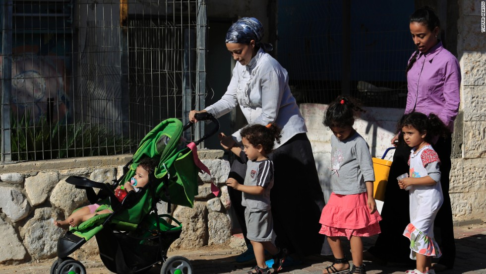 Israelis flee after a rocket fired from Gaza hit the residential neighborhood of Sderot, Israel, on August 8.