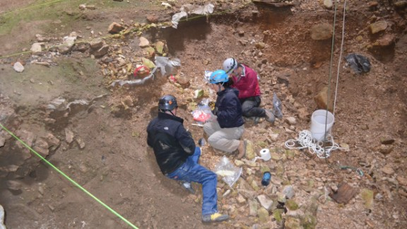 Justin Sipla, left, Julie Meachen and Jenna Kaempfer collect samples for analysis.