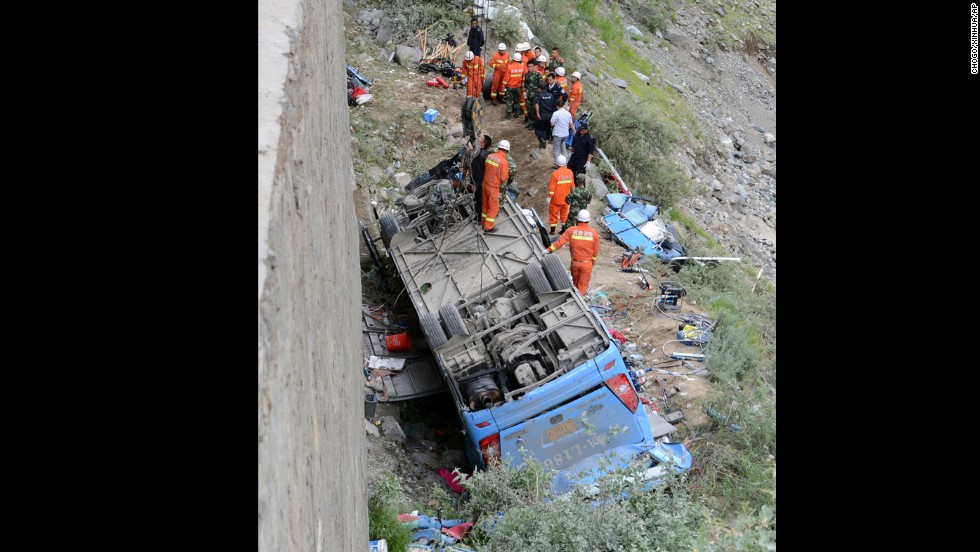Workers attempt to use a crane to lift the bus after the accident.  China's Xinhua News Agency reported that it crashed in a pileup invovling a sports utility vehicle and a pickup truck.