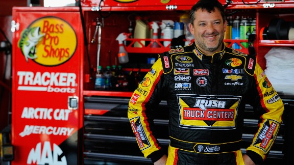 Caption:WATKINS GLEN, NY - AUGUST 08: Tony Stewart, driver of the #14 Rush Truck Centers/Mobil 1 Chevrolet, looks on in the garage area during practice for the NASCAR Sprint Cup Series Cheez-It 355 at Watkins Glen International on August 8, 2014 in Watkins Glen, New York. (Photo by Jared C. Tilton/Getty Images)