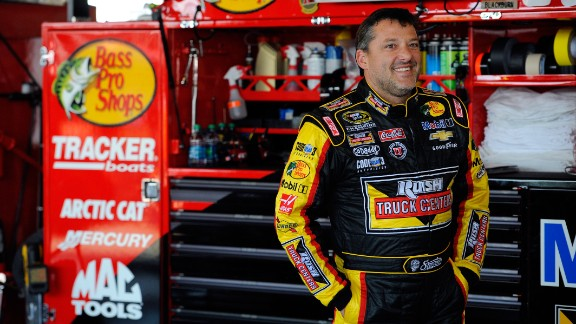 NASCAR driver Tony Stewart looks on in the garage area during practice for a race in Watkins Glen, New York, on Friday, August 8. Stewart is a three-time champion in NASCAR