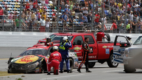 Stewart gets out of his car after a crash in Daytona Beach, Florida, in July 2014.