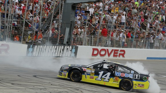 Stewart celebrates with a burnout after winning a race in Dover, Delaware, in June 2013.