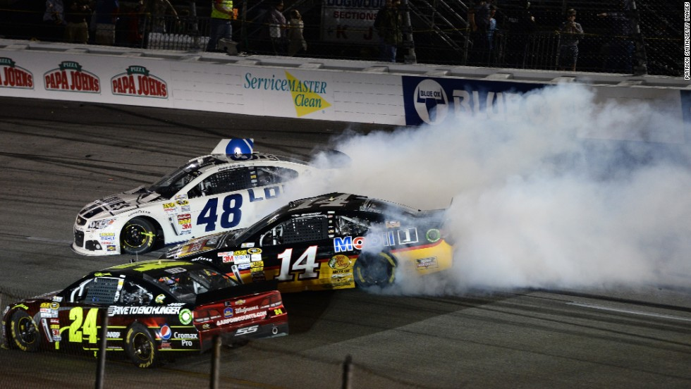 Stewart, in car No. 14, spins out after a wreck in Richmond, Virginia, in April 2013.