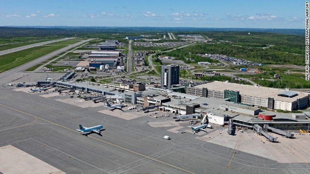 The Halifax Stanfield International Airport in Nova Scotia, Canada, is reviewing security measures after a woman climbed over a security fence on Sunday, officials say.