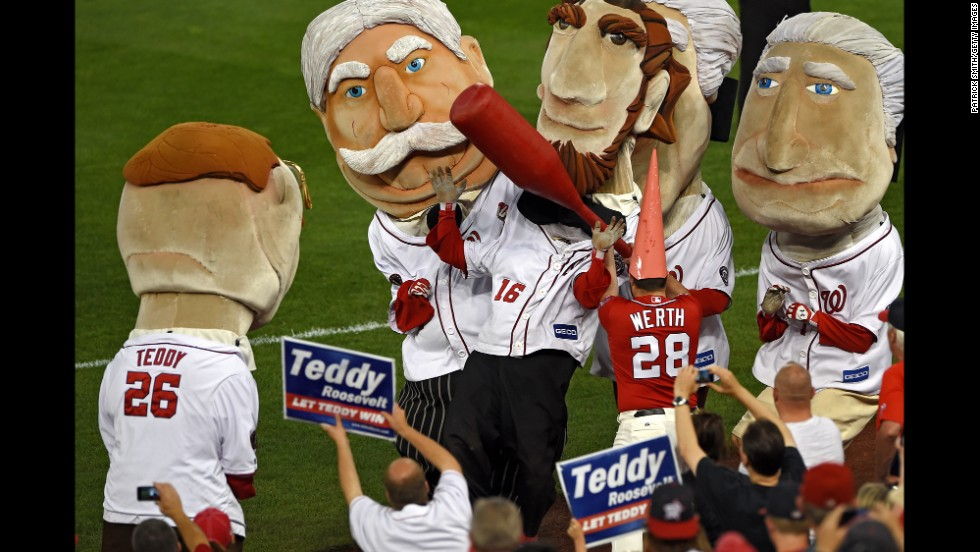 "A staff member of the Washington Nationals, dressed as the <a href=""http://www.washingtonpost.com/blogs/dc-sports-bog/wp/2014/08/06/the-jayson-werth-garden-gnome-market-is-red-hot/"" target=""_blank"">gnome giveaway</a> of Nationals outfielder Jayson Werth, hits Abraham Lincoln during the fourth-inning Presidents Race on Tuesday, August 5. The Presidents Race is a staple of every Nationals baseball game."