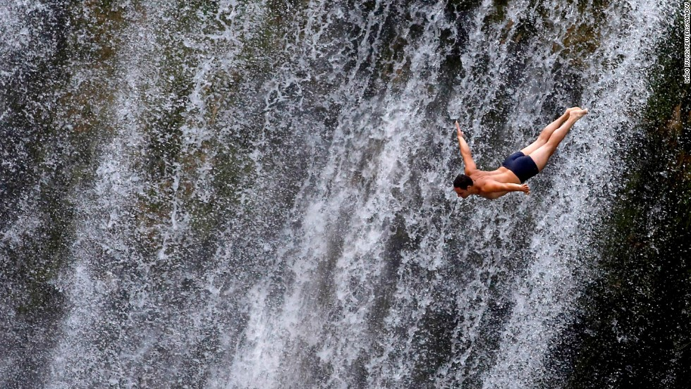 "A competitor takes part in an international waterfall jumping competition held in Jajce, Bosnia-Herzegovina, on Saturday, August 9. <a href=""http://www.cnn.com/2014/08/05/worldsport/gallery/what-a-shot-0805/index.html"">See 39 amazing sports photos from last week</a>"