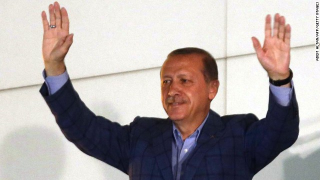 Newly elected Turkish president Recep Tayyip Erdogan waves at supporters from the balcony of the AKP party headquarters during the celebrations of his victory in the presidential election vote in Ankara on August 10, 2014.