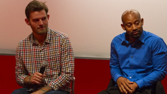 "Garrett Combs, left, and Delon Beckett this month at a screening of ""The War Comes Home."""