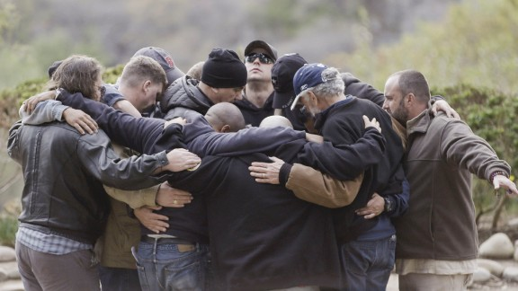 A Save a Warrior class forms a support circle.
