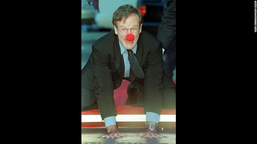 "Williams wears a clown nose as he places his hands in concrete during a ceremony outside Mann's Chinese Theatre in Hollywood in 1998. In the critically acclaimed ""Patch Adams,"" he played a doctor who used humor to help heal his patients"