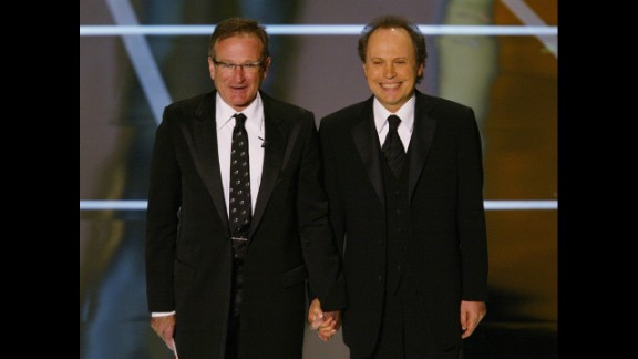Williams and Oscar host Billy Crystal perform at the 76th Academy Awards show in 2004.