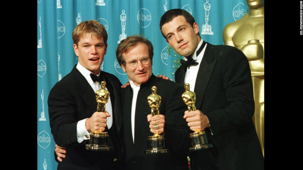 "Actor-writers Matt Damon, left, and Ben Affleck, right, pose with Williams, holding the Oscars they won for ""Good Will Hunting"" at the 70th annual Academy Awards in 1998. Damon and Affleck won for best original screenplay, and Williams won for best supporting actor."