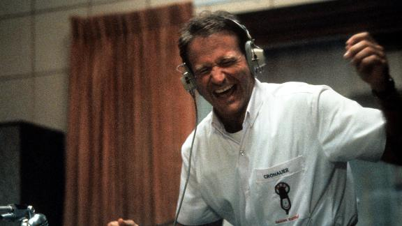 "Williams enjoys music through a headset in a scene from the film ""Good Morning, Vietnam"" in 1987."