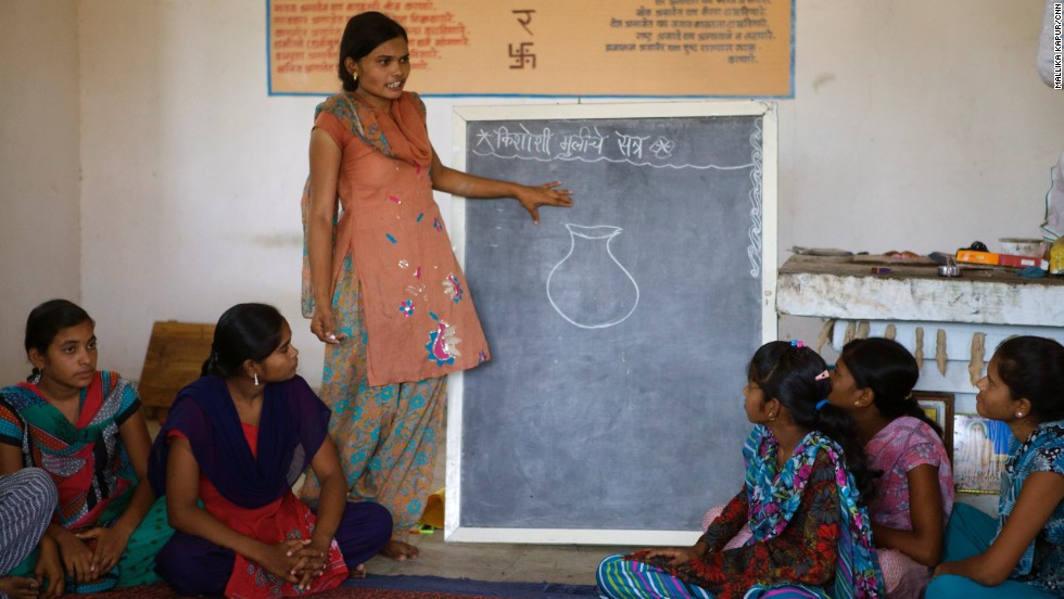 Sadhana leads a session that teaches village girls about the importance of saving.