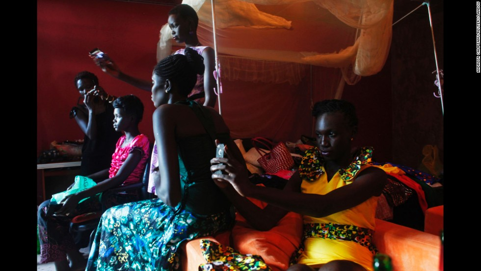 Models take selfies Saturday, August 9, during the Festival of Fashion and Arts for Peace in Juba, South Sudan.