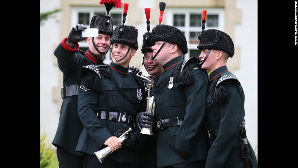 Buglers with the British Army's 3 Rifles battalion take a selfie Monday, August 11, during a handover ceremony at the Dreghorn Barracks in Edinburgh, Scotland.