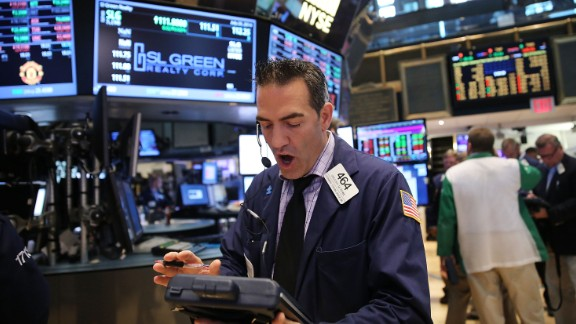 Traders work on the floor of the New York Stock Exchange in July 2014.