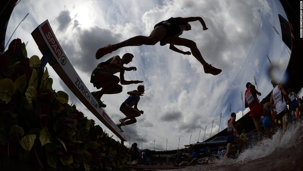 "AUGUST 12 - ZURICH, SWITZERLAND: Athletes compete in the men's 3000 meter steeplechase heats at the European Athletics Championships at the Letzigrund stadium. The event will host <a href=""http://www.zuerich2014.ch/en/group-1/event/facts-and-figures"" target=""_blank"">around 1400 athletes from 50 countries</a> and will last for six days."