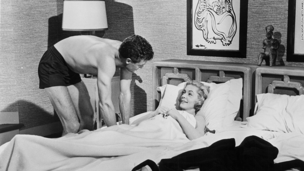 "Robert Stack and Bacall in a scene from 1958's ""The Gift Of Love."""