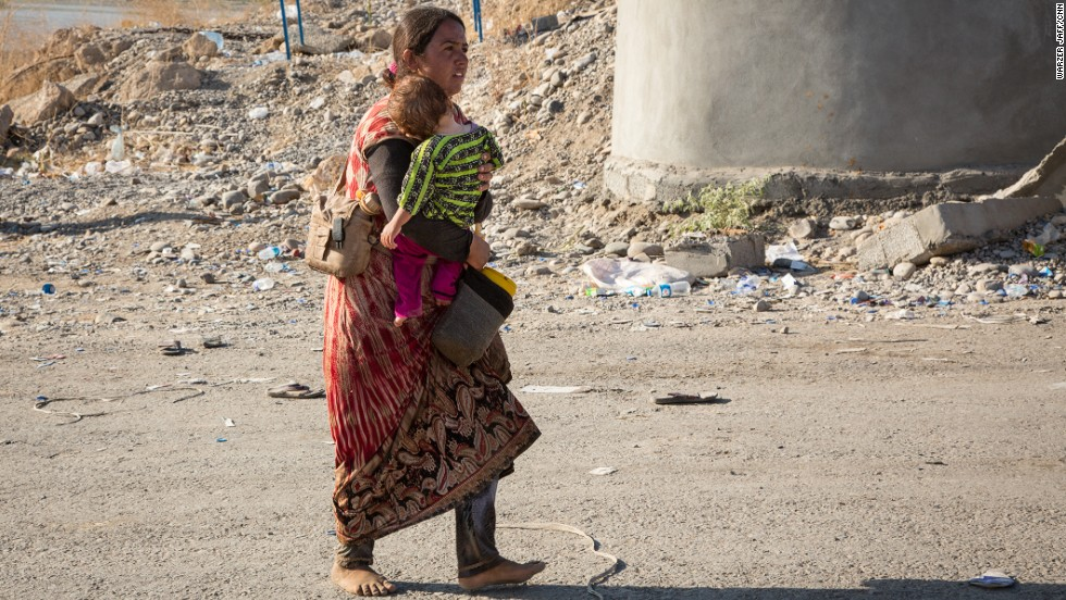 A senior Kurdish official estimated that as many as 70,000 people remain trapped on Mount Sinjar, and that at least 100 have died so far from dehydration and the heat. CNN could not independently confirm those estimates.