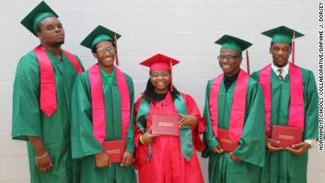 Michael Brown (far left) stands with fellow graduates at Normandy High School Summer graduation.