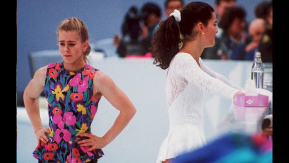 "Tonya Harding, the first female figure skater to complete a triple axel in competition, received a lifetime ban from U.S. Figure Skating after her ex-husband attacked rival skater Nancy Kerrigan before the 1994 Winter Olympics. The U.S. federation concluded that Harding, seen here at left next to Kerrigan, knew about the attack beforehand and engaged in ""unethical behavior."""