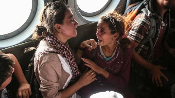 Aziza Hamad, 14, talks to her mother minutes after being rescued from Mount Sinjar in Iraq on August 14, 2014. A year after she and other Yazidi Iraqis were saved from the murderous advance of ISIS, CNN's Ivan Watson tracked Aziza down.