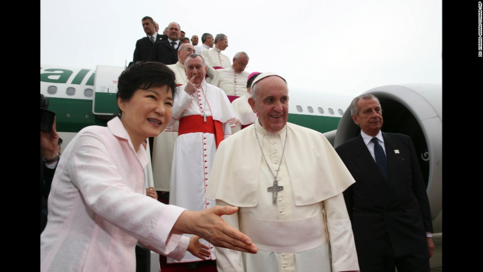Pope Francis is escorted by Park upon his arrival at Seoul Military Airport in Seongnam.