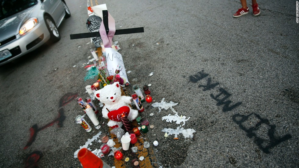 A makeshift memorial sits in the middle of the street where Michael Brown was shot and killed.