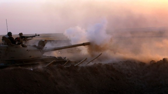 Iraqi Kurdish Peshmerga fighters fire at ISIS militant positions from the front line in Khazer, near the Kurdish checkpoint of Aski kalak, west of Arbil, the capital of the autonomous Kurdish region of northern Iraq, on Thursday, August 14.