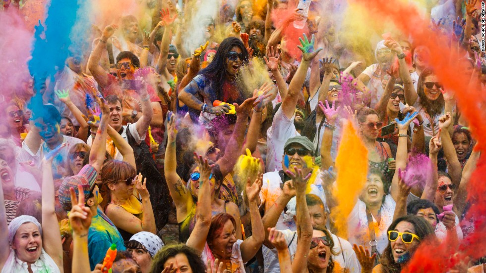 "Revelers in Madrid throw colored powder in the air during the Holi Festival of Colors on Saturday, August 9. The festival was fashioned after the <a href=""http://www.cnn.com/2014/03/17/asia/gallery/holi-2014/index.html"">annual Hindu festival</a> that celebrates the arrival of spring."